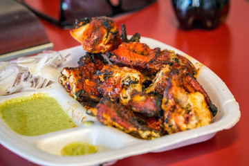 Close up portrait of indian tandoori chicken with souce.