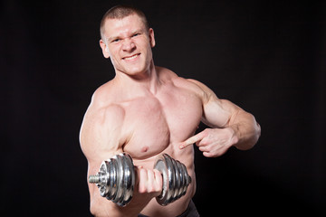 Sport the athlete bodybuilder build muscles dumbbells