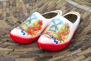 Typical dutch wooden clogs (klompen), painted with tulips and a windmill