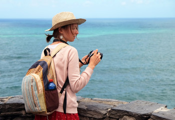 Pretty girl tourist on the beach