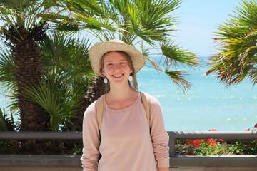 Girl tourist on the beach