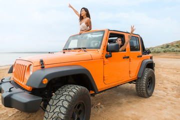 Two beautiful young women having fun while driving