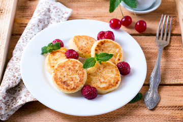 Syrniki (Cottage cheese pancakes) traditional Ukrainian and Russian cuisine