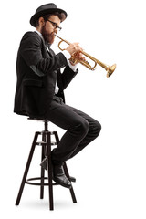Trumpet player sitting on a chair
