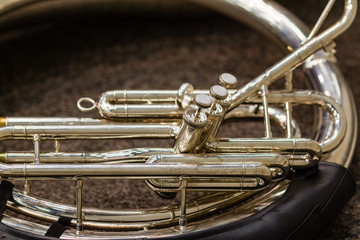 sousaphone resting on the floor waiting for its turn to perform