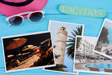 Summer vacation concept, vintage board. hat, glasses, message, photos.