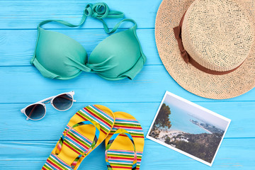 Beach clothing stuff for woman. Bra, hat, glasses, slippers, picture.
