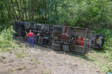 Real event, Truck accident, The truck crashed on the road and overturned. Carriage of new cars.