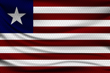National flag of Liberia on wavy fabric with a volumetric pattern of hexagons. Vector illustration.