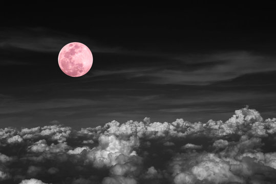 Pink full moon and cloud  in the dark sky at night , color effect