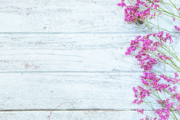 Pink dry flowers on old wooden background ,soft effect focus