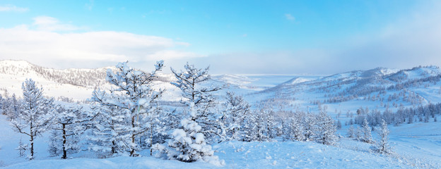 Lake Baikal. Panoramic view from the hill to the Kurkutskaja bay after the snowfall
