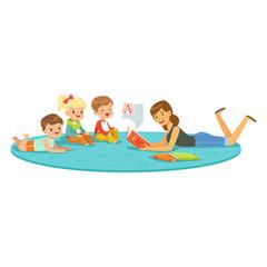 Teacher reading a book to kids, children enjoy listening, kids education and upbringing in school, preschool or kindergarten, colorful characters