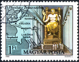 UKRAINE - CIRCA 2017: A postage stamp printed in Hungary shows Statue of Zeus in Olympia, by Pheidias, from series Seven Wonders of the Ancient World, circa 1980
