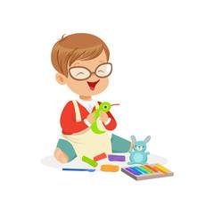 Cute little boy making figures from a plasticine, kids creativity vector Illustration