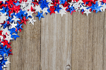 USA red, white and blue stars on weather wood background