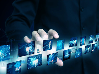 businessman holding technology