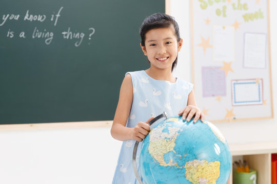 Portrait of smiling girl standing in the classroom
