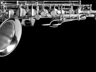 Saxophone isolated on black background.