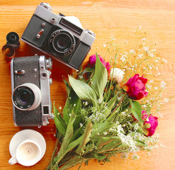 vintage camera near of flowers and candles
