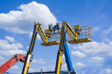 Lift buckets in the blue sky with clouds