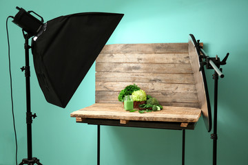 Professional equipment and vegetable juice in photo studio. Concept of food photography