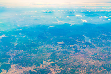 Aerial view over Earth Sea and Coast ,View from the airplane .