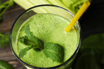 Glass of fresh vegetable juice on table, close up