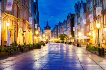 Gdansk long street at night. In the background the Gold Gate.