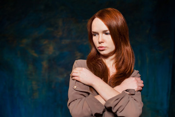Dissatisfaction red-haired woman posing