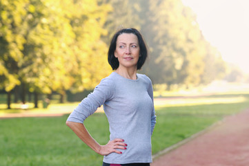 Portrait of mature woman before or after jog in the park
