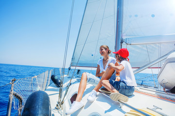 Brother and sister on board of sailing yacht on summer cruise. Travel adventure, yachting with child on family vacation.