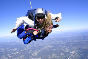 Skydiving tandem having fun