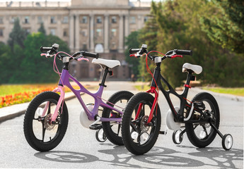 Modern children's bicycles outdoors on sunny day