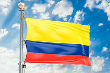 Colombian flag waving in blue cloudy sky, 3D rendering
