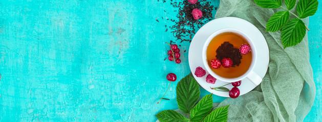 Freshly brewed tea with summer ripe berries. Top view, Banner format