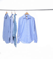 Blue shirt on hanger isolated on white background