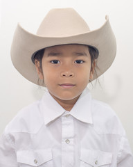 young boy wear cowboy hat isolate on white