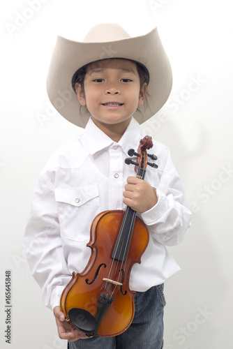 a2150934775c6 Asian boy wearing a cowboy hat holding a violin - isolated on white  background.