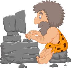 Cartoon caveman using a stone computer