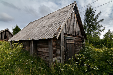 Old wooden barn in the village/ Old wooden barn in the village, Leningrad region, Russia