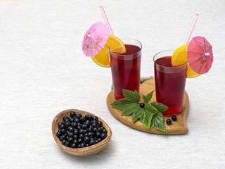 Black currant juice with black currant berries.