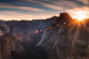 Half Dome rock climbing summits in beautiful golden  light at sunset in summer, Yosemite National Park, California, USA