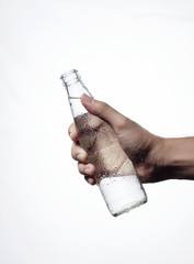 Holding water from bottle glass isolated white background.