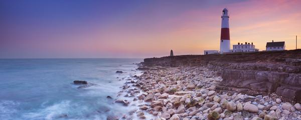 Fototapete - The Portland Bill Lighthouse in Dorset, England at sunset