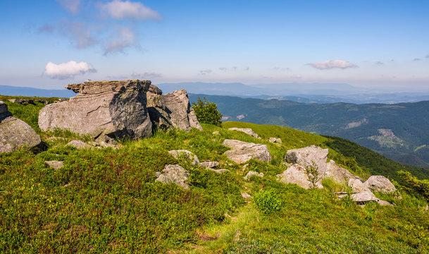 huge rocks on the edge of hillside