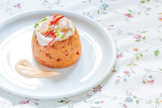 Delicious spanish Fish cake. Hake cake with tuna, tomato, shrimps, chive and salad cream.