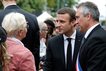 French President Emmanuel Macron greets peope after a mass to pay tribute to French priest Father Jacques Hamel in Saint-Etienne-du-Rouvray near Rouen