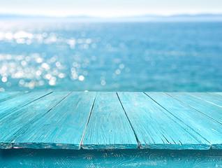 Fototapeta summer desk table against the sunny sea