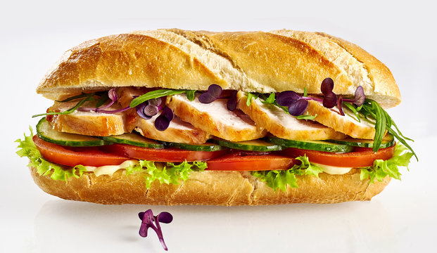 Healthy salad roll baguette with sliced chicken breast isolated on white background